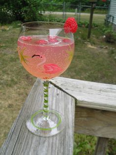 The Sarasota,  Ingredients:  1 large bottle of Moscato wine  1 (12 oz.) can of raspberry lemonade concentrate  1 (12 oz.) can of Sprite  Fresh raspberries