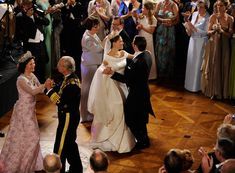 Crown Princess Victoria of Sweden and Prince Daniel of Sweden, Duke of Vastergotland (C) Queen Silvia and Carl XVI Gustaf of Sweden (L), and Eva Westling and Olle Westling, parents of the groom, dance after the Wedding Banquet at the Royal Palace on June 19, 2010 in Stockholm, Sweden.