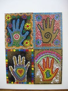 Ms Maggie Mo's Australian Aboriginal hand project: spray hand with thinned white or black tempera, student paints dots with sticks. I showed 1988 Nat Geo Aborigine video of Gagadju Aborigines blowing paint from mouths over hands as part of ritual. Awesome video also shows artist making intricate bark painting. by colleen