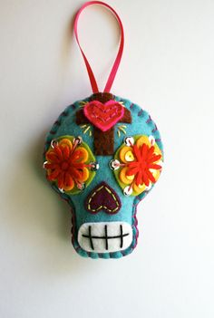 This listing is for a CUSTOM made sugar skull similar to this one. This particular piece just sold in a Brick and Mortar shop and is no longer available. If you would like a similar one made, I would be happy to recreate one for you. Just let me know! Please allow 1 full week for production.    *******************************************    This hand made sugar skull ornament is a one of a kind. Hes lovingly crafted out of 100% wool felt and painstakingly detailed with embroidery thread…