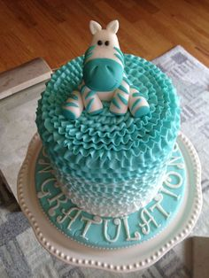 Gotta make a baby boy shower cake - maybe something like this with safari animals on top??