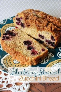 Blueberry Streusel Zucchini Bread - Use up that zucchini from your garden with this delicious blueberry version topped with a cinnamon and brown sugar streusel!