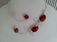 Here is an amber brown open necklace made with silver alu metal wire and acrylic beads. Perfect to wear in any occasions : wedding, prom, anniversary, ceremony . *** With the purchase of this ne Amber Necklace, Wire Necklace, Wire Wrapped Necklace, Amber Jewelry, Collar Necklace, Copper Jewelry, Prom Necklaces, Prom Jewelry, Metal Necklaces