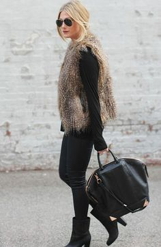 a brown fur vest looks so effortlessly chic with an all-black ensemble: