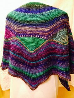 Sassy Short Row Shawl  byLeslieAnn Molnar-Grabowski. Pattern can be purchased at Ravelry.