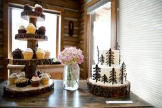 My husband sliced wood they had chopped down in the forest and then sealed so food could be used on it.  He made the cupcake stand and thick wood slice for our wedding cake.