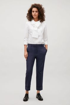 COS image 1 of Straight tailored wool trousers in Blue