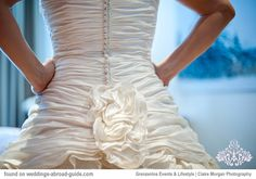 Kara wore a stunning bridal gown by British designer Ian Stewart (Paramount collection). Made from silk dupion, the dress had a finely pleated strapless bodice delicately encrusted with Swarovski crystals at the neckline | weddingsabroadguide.com