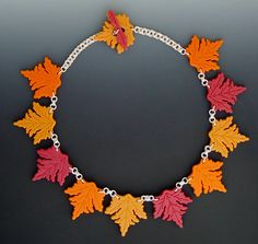 """Neckpiece: """"Autumn Leaves"""" (plastic toothpicks, sterling jump rings  - designed and created by Karen J Lauseng)."""