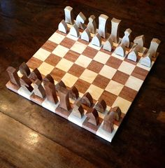 The solid Mahogany and Maple Chess Set is by far one of our favorite pieces to build. Each piece is designed and cut by hand in our home