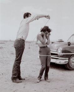 "1956: Liz Taylor and James Dean on ""Giant"" set .....good to see james dean roping in the Lizzy..."