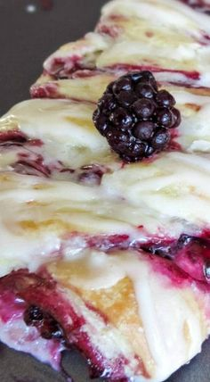Vanilla Glazed Blackberry Cheese Danish Braid ~ Glazed Blackberry Cheese Danish. Juicy, homemade blackberry preserves over a bed of sweet cream cheese, all wrapped up in a buttery, flakey dough. De-freaken-licious