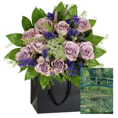 £30.00 - Monet Bouquet. Inspired by The Water-Lily Pond. This #bouquet features Memory Lane Roses with their dark mauve edge fading to a lilac centre, contrasted with the deep purple Statice. A central stem of Ammi speckles the bouquet with white flecks of 'light'. Pale pink Veronica and spring green Thlaspi represent the weeping willow surrounding #Monet's garden. This delicate bouquet is framed by lily-pads and come with a complimentary wrap. #MothersDay