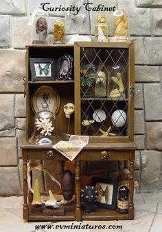 "Handmade 1"" to 1' Fantasy Dollhouse Miniatures. Including Leather Bound Books, Wands, Hourglasses, Potions, Celestial Instruments, and other miniatures for your witch and wizard."