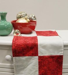 A reversible table runner made from your favorite holiday fabrics is an easy accent for a festive table!