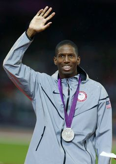 Michael Tinsley of the U.S. waves after receiving his silver medal during the men's 400m hurdles victory ceremony at the London 2012 Olympic Games at the Olympic Stadium August 6, 2012.