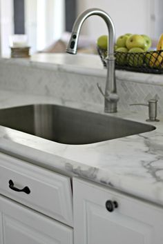 """Karran undermount sink can be used with formica countertops. New """"ideal edge"""" formica countertops in Calcutta marble. Love the real marble backsplash."""