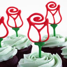 Rose made with chocolate as a cupcake topper. Draw rose first let it cool on the parchment paper and then draw the stem.. let it cool and then put it on a cupcake!