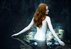 Such beautiful pale skin...and the reflection in the water.By zemotion