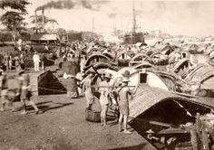 Loading Cascos in Pasig River, Manila, Philippines. Late 1800