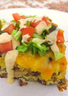 Bacon Cheeseburger Pie - beef, bacon, cheese and a quick Bisauick batter. Top with favorite burger toppings.