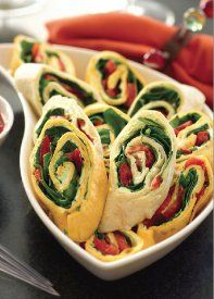 "Pretty Party Pinwheels - An easy appetizer recipe that will wow any crowd, these roll-ups are simple to make and so delicious! Made with tortillas, cream cheese and other yummy ingredients, it's easy to see why these ""pinwheels"" are crowd-pleasers!"