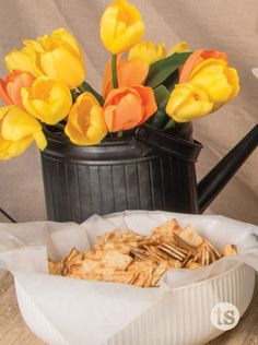 Family Reunion Menu | Tastefully Simple | Use a watering can as a vase for an easy decoration.