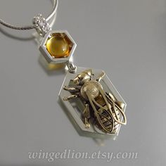 HONEY BEE silver and 14k gold pendant with citrine and white sapphires by WingedLion on Etsy https://www.etsy.com/listing/247998316/honey-bee-silver-and-14k-gold-pendant