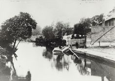 "Caption: ""Boats sunk in the River Brent at Hanwell"""