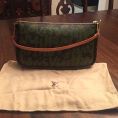 """HP LOUIS VUITTON Steven Sprouse pouchette Brown, tan, and green monogram canvas pouchette with zipper closure. It is guaranteed authentic with date code as pictured and includes original dust bag. Very good condition with general light wear. Drop is 6"""". Height is 5"""" and width is 8"""". Steven Sprouse edition which is rare. Louis Vuitton Bags"""