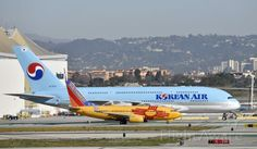 Boeing 737-700 & Airbus A-380 Taxiing to gate at LAX