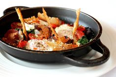Josper baked eggs with chorizo, red onion, spinach, and goat's cheese