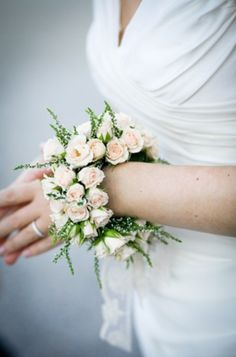 An example of quite a large female wedding wrist corsage with pale blush pink spray roses. A bridesmaid bouquet alternative perhaps? Probably best for a summer or spring wedding where people dont need jackets and coats over their arms xx Corsage Wedding, Bridesmaid Bouquet, Wedding Bouquets, Prom Corsage, Bridesmaids, Alternative Buttonholes, Alternative Bouquet, Flower Corsage, Wrist Corsage