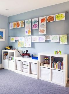 Use curtain wire to keep your artwork organized.