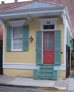 New Orleans pretty painted house - tiny shotgun house- dress up plain facade w molding and shutters House Design, Cottage, House, Cottage Exterior, New Orleans Homes, Exterior House Colors, Yellow Houses, House Painting, Small House