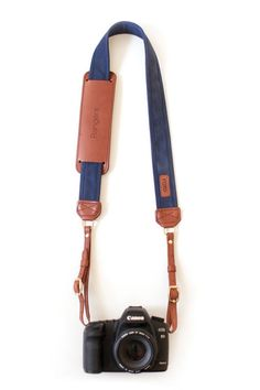 The Navy Fotostrap - a classic navy canvas and leather camera strap!  All Fotostraps are made in the USA, give 10% back to Fotolanthropy, and offer custom monogramming to the leather shoulder pad.  Add your name, initials, monogram, or even a business logo!  Shop at www.fotostrap.com.