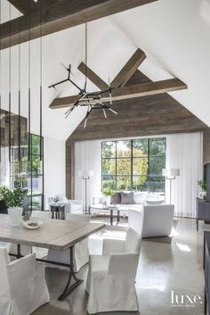 This space is a perfect mix of modern statement pieces, clean white and rustic wood. Those grey exterior wood details get me every time! Concrete floors and li