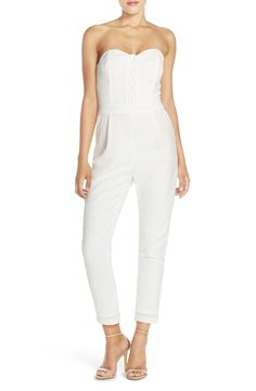 Free shipping and returns on Adelyn Rae Strapless Lace-Up Jumpsuit at Nordstrom.com. Lace-up detailing accents the strapless sweetheart bodice of a high-waisted jumpsuit with cropped, slim-fitting legs for an up-to-the-minute look.