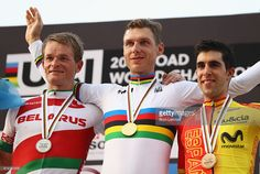 Silver medalist Vasil Kiryienka of Belarus, gold medalist Tony Martin of Germany and bronze medalist Jonathan Castroviejo Nicolas of Spain celebrate on the podium during the medal ceremony for the Men's Elite Individual Time Trial on Day Four of the UCI Road World Championships at Lusail Sports Complex on October 12, 2016 in Doha, Qatar.