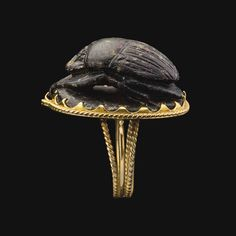 Steatite scarab mounted in modern gold setting. Third Intermediate Period. 22nd dynasty. Reign of Shoshenq I. 945-924 B.C. | Christie's