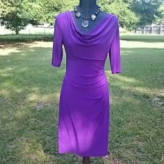 """*HP* 4/20 Ralph Lauren Iris Cocktail Dress Vibrant purple cocktail dress with draped neck (with weight to keep draping in place) and touched shoulder. Beautiful side rouching for tummy camouflage! Slimming Jersey knit, 95%polyester 5% elastane. Lined with same material. Measures 28"""" at waist, 40"""" from shoulder seam to bottom hem, sleeves 12"""", hips approx 36"""". Stunning! Ralph Lauren Dresses"""