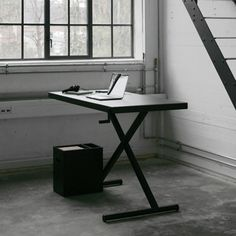 this office desk by Danish design studio KiBiSi is a cross between an ironing board and a car jack – simply turn the handle on the corner to raise or lower the surface.
