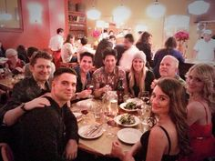The original Glee Family Eating & Having A Great Time. Cory's there in spirit