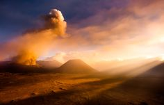 """Great light during an eruption of Mt. Bromo in Indonesian. Photo """"Light on the Moon"""" by Dan Ballard."""