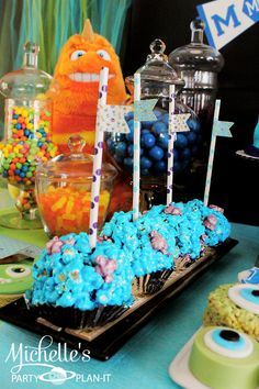Sulley popcorn balls on a stick. Straws from #pickyourplum #PYP Michelle's Party Plan-It: Monsters Pre-Scare School