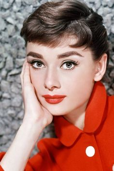 Audrey Hepburn photographed by Bud Fraker, 1953. I love the red coat with the white button details...