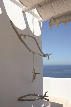 wouldn't it be fun to while away holiday hours making driftwood mobiles? - PORTO/41, POLIGNANO A MARE, 2011