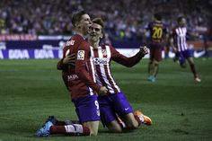 Fernando Torres (L) celebrates scoring their opening goal with teammate Antoine Griezmann (R) during the La Liga match between Club Atletico de Madrid and FC Barcelona at Vicente Calderon Stadium on September 12, 2015 in Madrid, Spain.