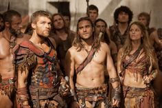 If the woman wasn't there, this would be the slaves of the Arena.  (Liam McIntyre as Spartacus, Dustin Clare as Gannicus and Ellen Hollman as Saxa in Spartacus: War of the Damned)