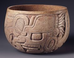 Late Classic, Maya (Chocholá style)  Bowl, deeply carved with K'awiil on one side, A.D. 600–900  Orangeware ceramic with white slip  h. 12.2 cm., diam. 16.0 cm. (4 13/16 x 6 5/16 in.)  Place made: Chocholá or vicinity, Maya area, Yucatán or Campeche, Mexico